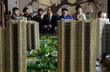 """房地產市場調控現新趨勢 政策""""蜜月期""""將來臨"""