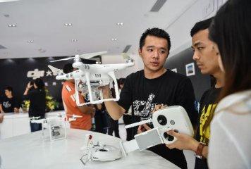 大疆聯合蘋果發售新品 無人機銷售管道爭奪戰升級
