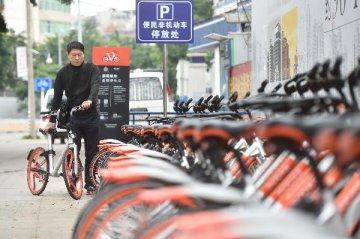 腾讯阿里对垒共享单车 新政难阻行业高烧