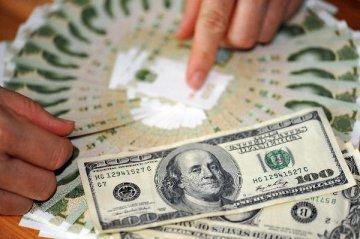 離岸人民幣對美元匯率失守6.97關口