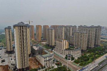 中國住房市場大資料:北上深房價轉跌 三四線漲幅近零