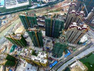 1-11月全國房地產開發投資額同比增長9.7%
