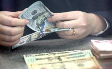在岸人民幣對美元高開高走逾300點 升破6.74關口